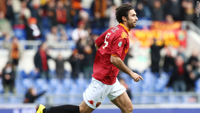 Mirko Vucinic wheels away after scoring the only goal of the game in the Stadio Olimpico.