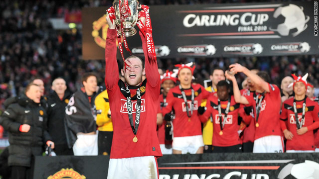 England and Manchester United striker Wayne Rooney lifts the Carling Cup trophy at Wembley stadium.