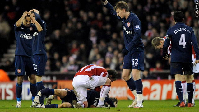 Arsenal's players reacted in horror as teammate Aaron Ramsey was left with a double leg fracture.