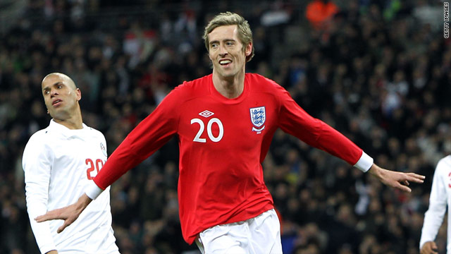 Peter Crouch grabbed a second half double to secure a 3-1 win for England at Wembley.