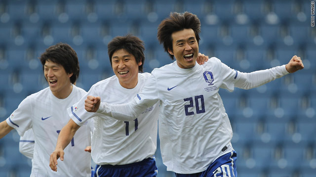 Lee Dong-gook (far right) celebrates his opening goal for South Korea at Loftus Road.