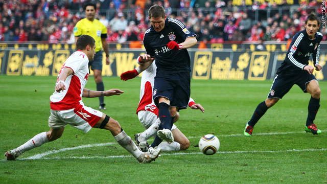 Bayern Munich's Bastian Schweinsteiger strikes the ball home to rescue a point in their Bundesliga clash at Cologne.