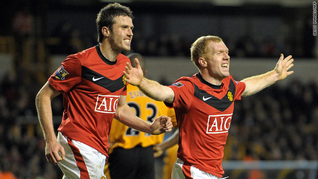 Paul Scholes celebrates his 100th goal in the English Premier League which gave Manchester United a 1-0 victory over Wolves.