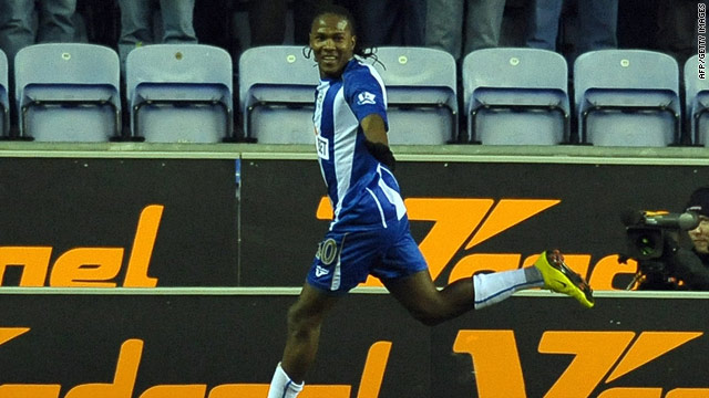 Hugo Rodallega celebrates the goal that gives Wigan a vital 1-0 victory over Champions League-chasing Liverpool.