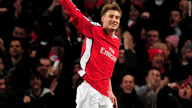 Nicklas Bendtner celebrates his opening goal as Arsenal crushed Porto to reach the Champions League last eight.