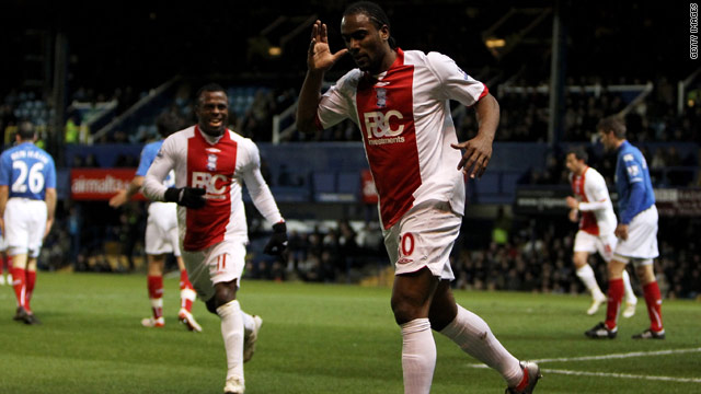 Cameron Jerome celebrates opening the scoring in Birmingham's 2-1 Premier League victory at Portsmouth.