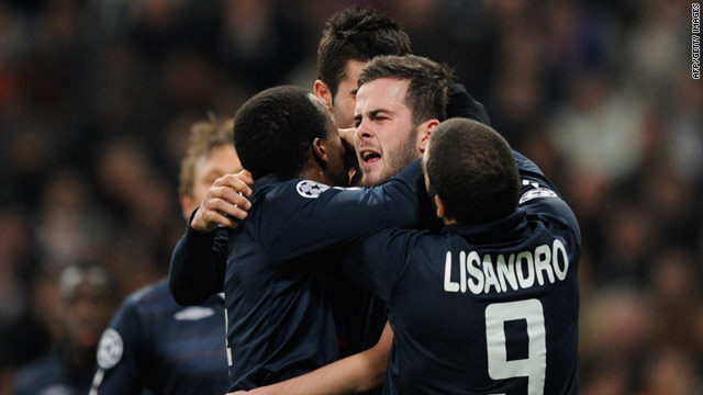 Lyon players rejoice at Miralem Pjanic's equalizing goal in the 1-1 draw at the Bernabeu Stadium.