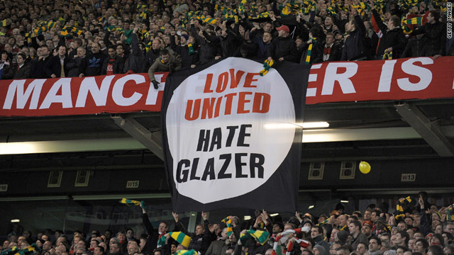 Manchester United fans unveil an anti-Glazer banner during their team's European Champions League game with AC Milan.