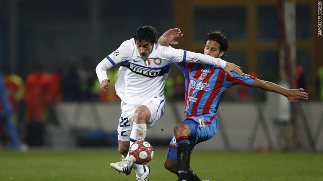 Diego Militio (left) tries to evade the Catania defence as the Italian leaders slumped to a shock 3-1 defeat.