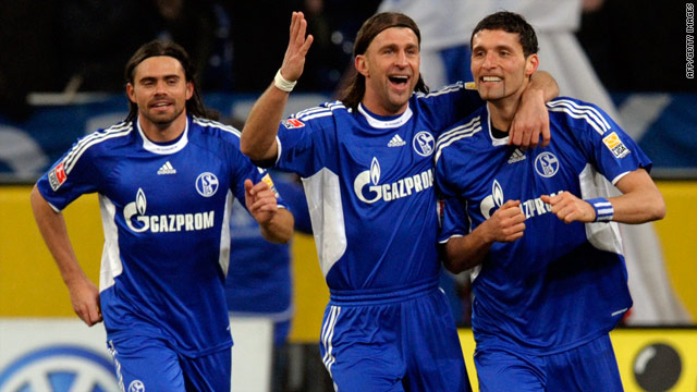 Kevin Kurany (right) celebrates his winning goal as Schalke beat Stuttgart to go back on top of the Bundesliga table.