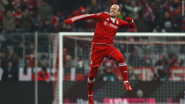 Robben leaps with delight as Bayern Munich go to the top of the Bundesliga standings.