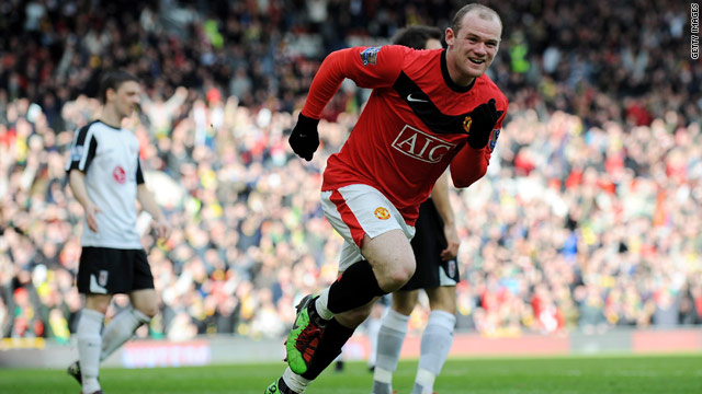 Wayne Rooney wheels away in delight after scoring his first goal in Manchester United's 3-0 victory against Fulham.
