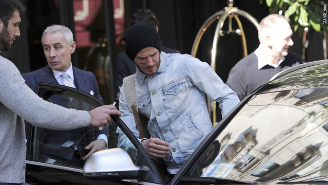 David Beckham shows the scars of battle on Monday as he heads to Finland for Achilles surgery.