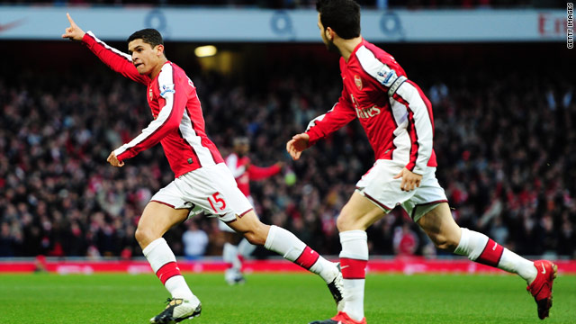Brazilian midfielder Denilson, left, celebrates his goal against West Ham with his Arsenal captain Ces Fabregas.