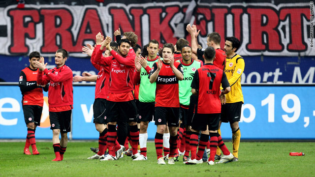 Eintracht Frankfurt's players celebrate after claiming the prize scalp of Bavarian giants Bayern Munich.