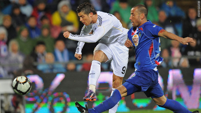 Cristiano Ronaldo fires home his second goal, and Real Madrid's fourth, in the 4-2 victory at Getafe.