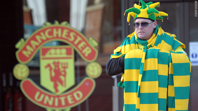 Fans have been wearing green-and-gold scarves to show their opposition to the Glazer ownership.