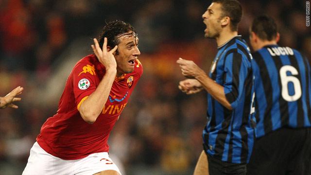 Roma striker Luca Toni celebrates after scoring the winner against Inter Milan on Saturday.