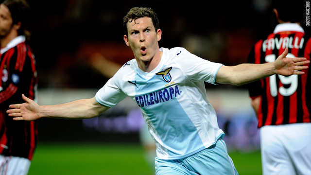 Stephan Lichsteiner celebrates his equalizing goal for Lazio in the 1-1 San Siro draw with AC Milan.