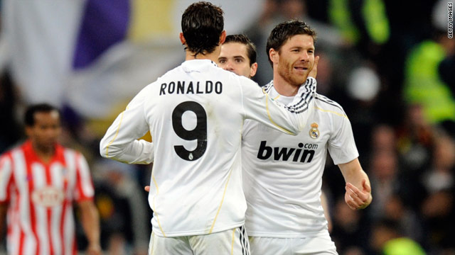 Xabi Alonso (right) is congratulated after scoring Real Madrid's equalizing goal in the 3-1 victory over rivals Atletico.
