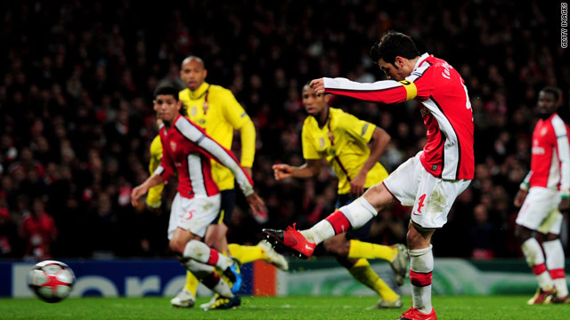 Cesc Fabregas fires home the equalizing penalty as Arsenal fought back to earn a 2-2 draw at home to Barcelona.