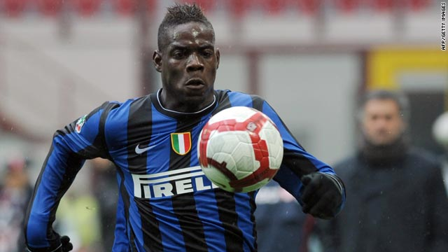 Striker Mario Balotelli was sidelined for three weeks after his row with Inter Milan boss Jose Mourinho, in background.