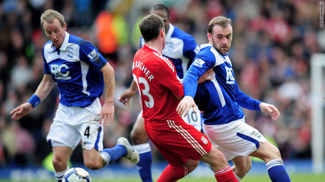 James McFadden (right) and Jamie Carragher challenge for the ball as Liverpool are held 1-1 at Birmingham.