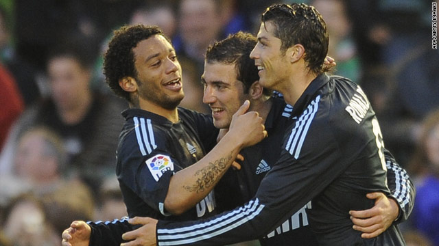 Cristiano Ronaldo (right) and Gonzalo Higuain (center) were both on target in another Real Madrid victory on Sunday.