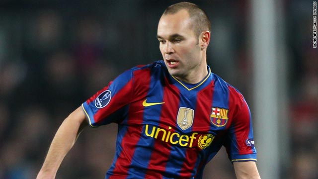 Midfielder Andres Iniesta has been named in Barcelona's 19-man squad to take on Arsenal at the Nou Camp.