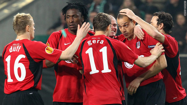 Bobby Zamora (second from right) is mobbed after his early goal for Fulham against Wolfsburg.