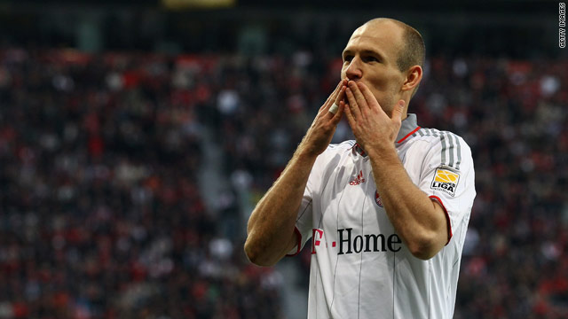 Arjen Robben celebrates his opener at Bayer Leverkusen but Bayern were held 1-1.
