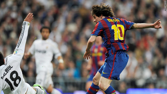 Lionel Messi fires the Barca opener past a desparing Raul Albiol in the Santiago Bernabeu.