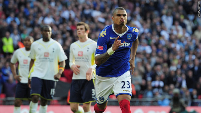 Kevin-Prince Boateng runs away after scoring Portsmouth's killer second from the spot at Wembley.