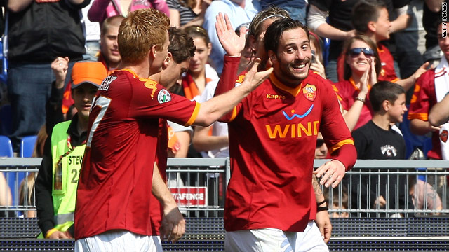Roma celebrate their second goal from Marco Cassetti in the Stadio Olimpico.