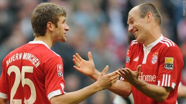 Thomas Muller and Arjen Robben celebrate another goal during Bayern Munich's 7-0 rout of Hannover.