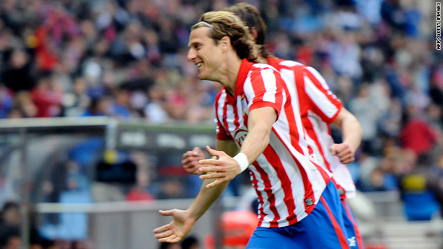 Diego Forlan scored the only goal to give Atletico Madrid a slender lead in their Europa League semifinal against Liverpool.
