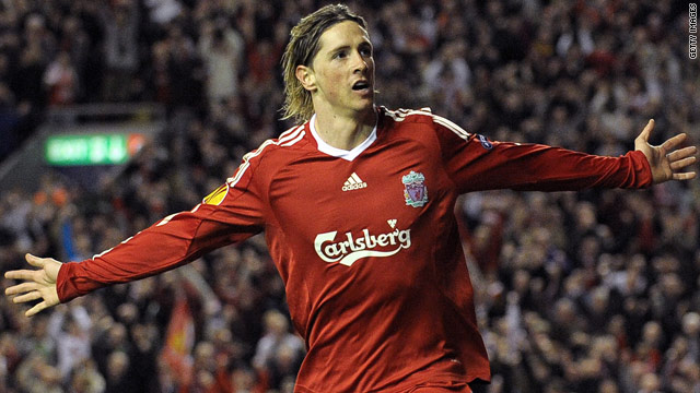Spain striker Fernando Torres is happy at Liverpool, according to his manager Rafael Benitez.