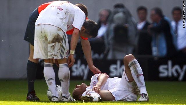 Bayern Munich defender Daniel Van Buyten lies injured on the pitch during the match at Borussia Moenchengladbach.