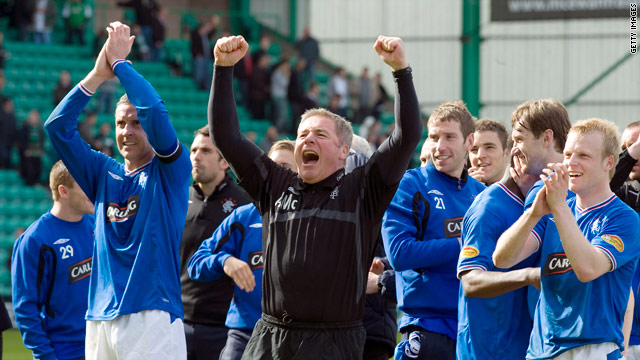 Rangers players and assistant coach Ally McCoist celebrate their title triumph.