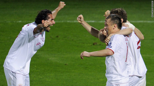 Hamit Altintop (left) celebrates with Ivica Olic and teammates after Bayern Munich's opening goal against Lyon.