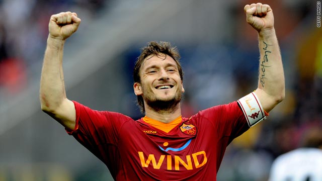 Roma captain Francesco Totti celebrates his opening goal in the 2-1 victory at Parma on Saturday.