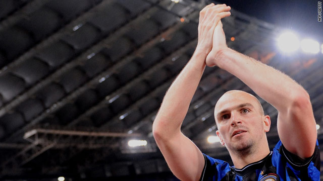 Inter midfiielder Esteban Cambiasso salutes the Inter fans after their win over Lazio.