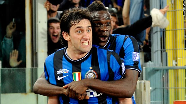 Inter Milan strikers Diego Milito, left, and Mario Balotelli celebrate after the Argentine's goal against Roma.