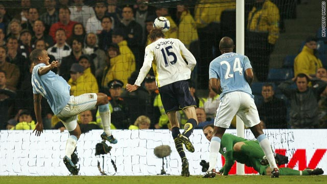 Tottenham striker Peter Crouch, center, heads home the only goal of the match against Manchester City.
