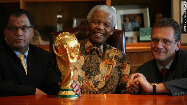 Nelson Mandela, center, with the World Cup trophy and organizing boss Danny Jordaan, left, and FIFA's Jerome Valcke.