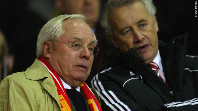 Liverpool co-owner George Gillett, left, with former chief executive Rick Parry, who received a $6 million payoff.