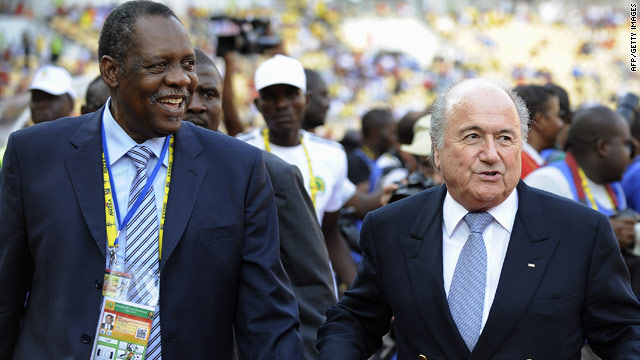 CAF president Issa Hayatou, left, and FIFA chief Sepp Blatter arrive for the African Nations Cup final in Angola on January 31.