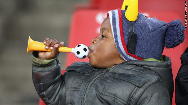 A young South Africa fan keeps warm at a Confederations Cup match in Johannesburg in June 2009.