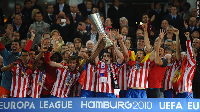 Atletico players lift the trophy after their extra time victory over Fulham.