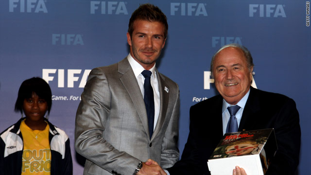 David Beckham hands over the official England bidding book to FIFA president Sepp Blatter.